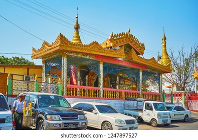 SAGAING, MYANMAR - FEBRUARY 21, 2018: The richly decorated Image House of Soon Oo Ponya Shin Paya (Summit Pagoda) with pyatthat roof and mirror patterns on columns, on February 21 in Sagaing
