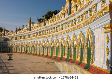Sagaing, Myanmar - January 16th, 2019: the facade of U Min Thonze Cave Pagoda, housing 45 buddha images, shines in the light of sunset
