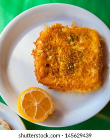 saganaki - fried cheese served with lemon, traditional greek appetizer