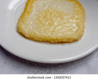 """""""saganaki"""" Greek fried goat cheese traditional ethnic plate close up"""