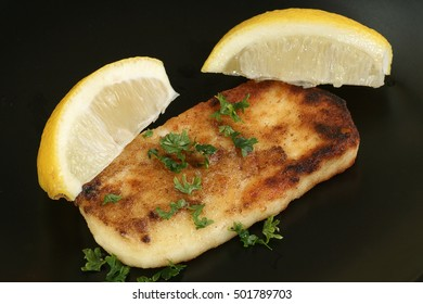 saganaki greek halloumi cheese appetiser with lemon wedges