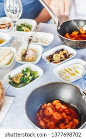 Saganaki and meze appetizers at the local greek restaurant. Healthy seafood and vegetarian snacks. Local mediterranean cuisine. Friendly dinner or lunch