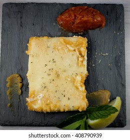 Saganaki. Traditional pan-fried Graviera cheese served with lemon marmalade