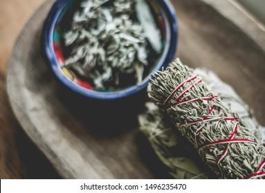 sage bundles and loose sage leaves in bowl