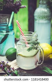 Sage and citrus infused drink on old wooden background, outdoors shot.