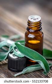 Sage essential oil and fresh sage