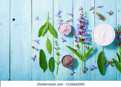 sage herbal plant parts and beauty product samples on turquoise wood table background