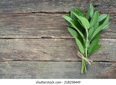 sage on wooden surface