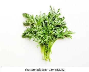Sagebrush on white wooden background. Shallow dof.