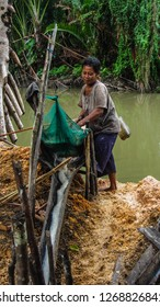 A sago farmer is making the sago by the river of Sawai Village, in the forest of Manusela National Park, Maluku, Indonesia, November 2013