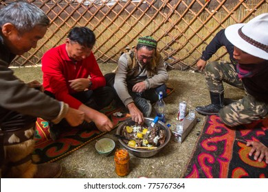 SAGSAI, BAYAN-OLGIY, MONGOLIA - SEP 28, 2017: Kazakh family of hunters with golden eagles inside the mongolian Yurt. In Bayan-Olgii Province is populated mainly by Kazakhs (88,7%)