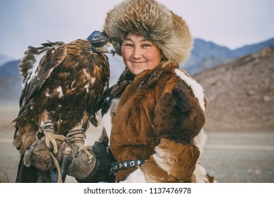 SAGSAY, MONGOLIA - SEPTEMBER 28, 2017: young woman berkutchi eagle hunter.