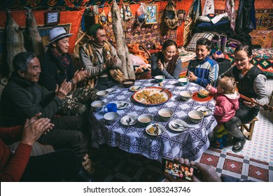SAGSAY, MONGOLIA - SEPTEMBER 30, 2017: Smiling Kazakh-Mongolian family into the yurt.