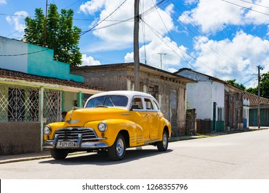 Sagua la Grande, Cuba - September 25, 2018: American yellow 1946 Chevrolet Fleetmaster vintage car with white roof parked on the side street in Sagua la Grande Cuba - Serie Cuba Reportage