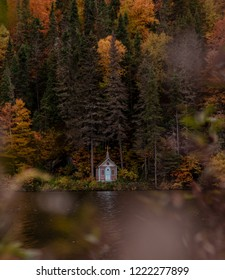Saguenay, Québec/Canada - 10 09 2018 : A small building alone in the woods at fall.