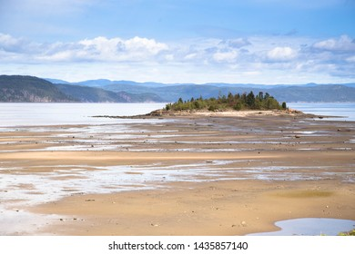 Saguenay Fjord in Quebec low tide with island exposed