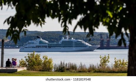 Saguenay, Quebec/Canada - 09 16 2018 : Cruises boats docked at the port of Saguenay, couple looking at boat.