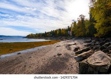 Saguenay river shore at atumn time. Quebec, Canada. Morning time