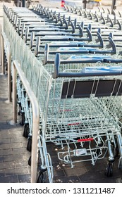 SAGUNTO, SPAIN - FEBRUARY 08, 2019: line of shopping carts in Lidl supermarket. Lidl is a German global discount supermarket chain