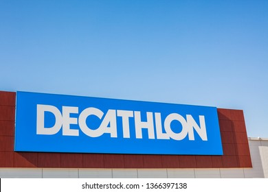 SAGUNTO, SPAIN - FEBRUARY 08, 2019: Decathlon store is a French company of sporting goods distribution retail chain brand logo at building located in Sagunto shopping area Spain. Blue sky background
