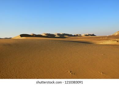 Sahara desert beautiful landscape nearby Dakhla oasis in Egypt at sunset. Africa