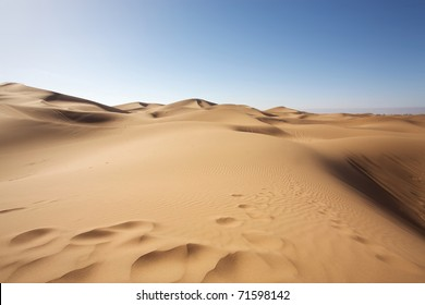 Sahara desert close to Merzouga in Morocco with blue sky and clouds