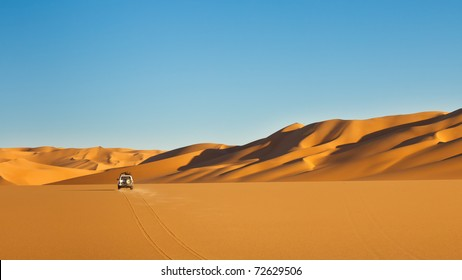 Sahara Desert Safari - Off-road vehicle driving in the Awbari Sand Sea, Libya