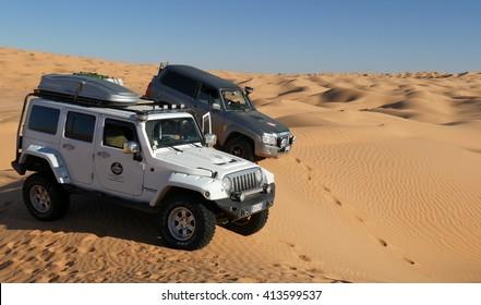 SAHARA DESERT, TUNISIA -  CIRCA OCTOBER 2015: off road cars in the desert during a safari.