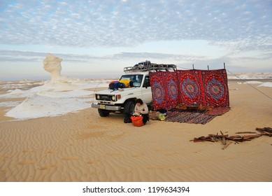 Sahara, Egypt - December 26, 2008: Sahara desert safari, off-road vehicle parking for camp into the sand Western White desert