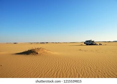 Sahara, Egypt - December 28, 2008: Sahara Desert safari off-road vehicle parking for camp into the sand desert nearby Dakhla oasis in Egypt