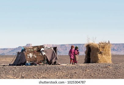 SAHARA, MOROCCO - JANUARY 6, 2014: Bedouins children playing at the camp in Western Sahara desert, Africa