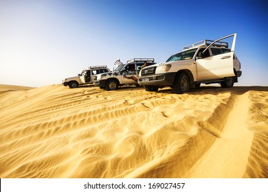 SAHARA, TUNISIA - JUL 10: Driving a 4-wheel drive SUV on the desert, traditional entertainment for tourists on July 10, 2012 in Sahara, Tunisia