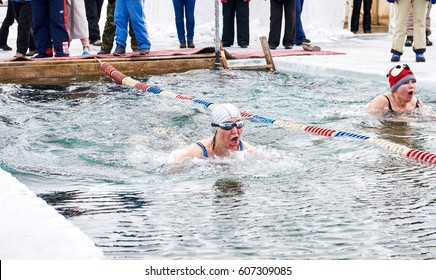 SAHYURTA, IRKUTSK REGION, RUSSIA - March 11.2017: Cup of Baikal. Winter Swimming Competitions. Two women. A strong breath