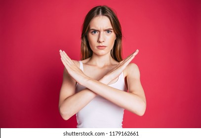 I said, no! Angry and frustrated woman shows her crossed arms in x gesture sign and looks on camera. Stop sign