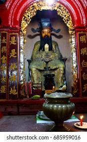 SAIGON - FEB 5, 2015 - Small altar with offerings in  Emperor Jade Pagoda, Chua Phouc Hai pagoda, Saigon (Ho Chi Minh City),  Vietnam
