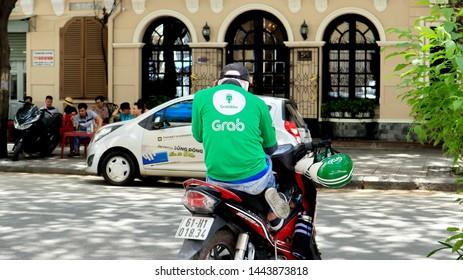 SAIGON, VIETNAM. 2019 Jun 19th. A Grab Driver at the Street