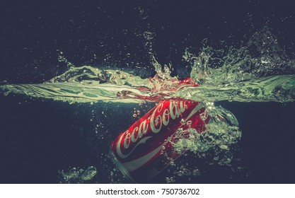SAIGON / VIETNAM - 29 OCT 2017, Coca Cola Can Falling into Water with Splashing