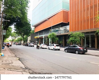 Saigon, Vietnam / 8 August, 2019: Photo of Ton That Tung street on sunny day with cars parking near pavement.