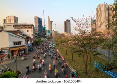 SAIGON, VIETNAM - APR 03, 2018 - Saigon streets turn pink with rosy trumpet flowers