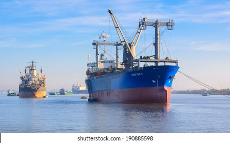SAIGON, VIETNAM - DEC 16: The Asian Fair II and others cargo ships in Saigon river, Vietnam.  On Dec 16, 2012.