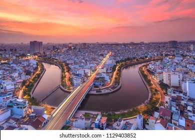 SAIGON, VIETNAM - DEC, 17, 2015: Aerial sunset view of houses and Business and Administrative Center of Ho Chi Minh city on NHIEU LOC canal