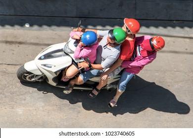 SAIGON, VIETNAM, DEC 17 2017, Vietnamese family rides a motorbike in the streets of Saigon, Vietnam.