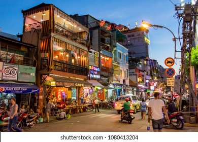 SAIGON, VIETNAM, DEC 17 2017, Sunset in the streets of Saigon, Evening Street with bars and pubs in the center of Ho Chi Minh city.