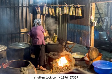 SAIGON, VIETNAM - FEB 13, 2018 - The vietnamese woman is cooking Banh Tet which preparing for TET holiday is a must have traditional food in Vietnamese Lunar New Year