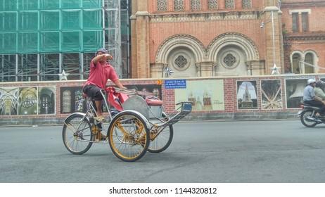 SAIGON, VIETNAM July 16, 2018: A man cyclo on the street. At SAIGON, cyclo is a type of tourism.