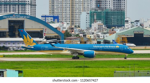 Saigon, Vietnam - Jun 24, 2018. An Airbus A350-900 airplane of Vietnam Airlines taxiing on runway of Tan Son Nhat Airport (SGN) in Saigon (Ho Chi Minh City), Vietnam.