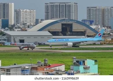 Saigon, Vietnam - Jun 24, 2018. A Boeing 777 airplane of Korean Air taxiing on runway of Tan Son Nhat Airport (SGN) in Saigon (Ho Chi Minh City), Vietnam.
