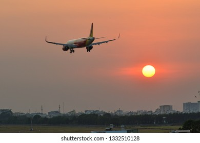 Saigon, Vietnam - Mar 2, 2019. An Airbus A320 airplane of Vietjet Air landing at Tan Son Nhat Airport (SGN) in sunset.