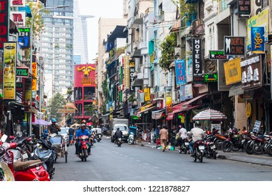 Saigon, Vietnam - March 10, 2018: The streets of Saigon (Ho Chi Min City) full of wires, colors and people.