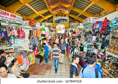 SAIGON, VIETNAM - NOV 17, 2013: People shopping at Ben Thanh Market on Nov 17, 2013 in Ho Chi Minh, Vietnam. Ben Thanh Market is biggest market and attraction in Ho Chi Minh City.
